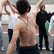 LONDON, ENGLAND - FEBRUARY 07: A Shiite Muslim devotee, showing several scars due to previous self flagellation on his back, beats up his chest during the 29th Arbaeen Procession on February 7, 2010 in London, England. Arbaeen occurs 40 days after the day of Ashura, the commemoration of the martyrdom of Imam Husain in Karbala (Photo by Marco Secchi/Getty Images)
