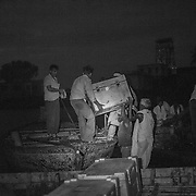 4:49am. The cold boxes contatining the polio vaccine are loaded onto the boats at Kusheshwar Asthan east, Bihar.