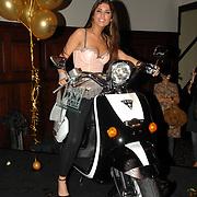 NLD/Amsterdam/20070515 - FHM verkiezing Meest Sexy vrouw van Nederland 2007, winnares Yolanthe Cabau van Kasbergen met haar gewonnen Guess scooter