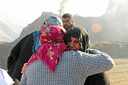 Relatives of the miners, who are trapped under the mine, wait as search and rescue team members work at the disaster site after a landslide caused a collapse at the private 'Madenkoy copper mine' in Turkey's southeastern Siirt Province's Sirvan District on November 19, 2016. Four killed and 14 workers are trapped under the wreckage after heavy rainfall led to the disaster at the Madenkoy copper mine. Photo by Depo Photos/ABACAPRESS.COM
