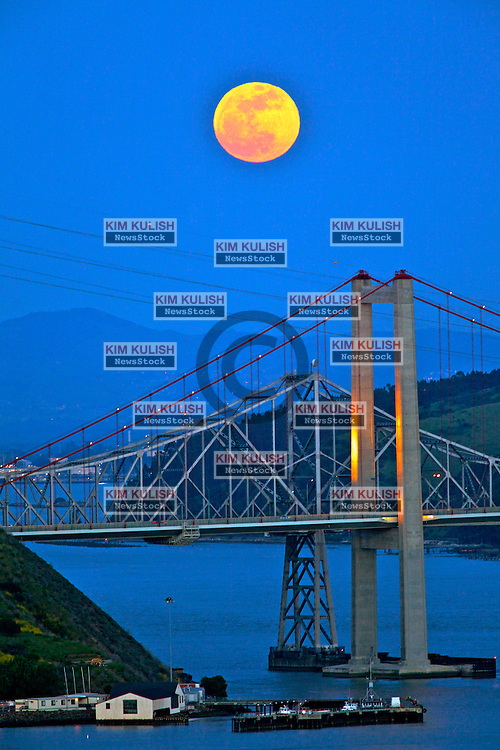 """A Perigee Moon rises over the Alfred Zampa Memorial Bridge spanning the Carquinez Strait in Vallejo, California.  The """"Supermoon"""" appears 14 percent larger and 30 percent brighter as it makes it's closest approach to the earth this year."""