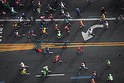 Participants run along 4th Ave in the New York City Marathon in Brooklyn, NY on Sunday, Nov. 3, 2013.<br /> <br /> CREDIT: Andrew Hinderaker for The Wall Street Journal<br /> SLUG: NYSTANDALONE