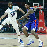 31 December 2017: LA Clippers guard Lou Williams (23) passes the ball past Charlotte Hornets guard Kemba Walker (15) during the LA Clippers 106-98 victory over the Charlotte Hornets, at the Staples Center, Los Angeles, California, USA.