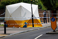 © Licensed to London News Pictures. 01/06/2014. LONDON, UK. Police officers investigating a crime scene in Sydenham, Lewisham after a 18-year-old man was stabbed to death in Wells Park Road. Photo credit : Tolga Akmen/LNP