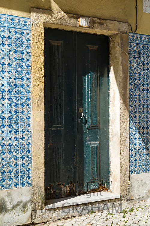 Typical doorway and Portugese Azulejos tiles near Calcada in Lisbon, Portugal