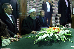 Iran's President Hassan Rowhani (C), praying over the tomb of the founder of Iran's Islamic Republic Ayatollah Ruhollah Khomeini, at the latter's shrine in southern Tehran. Rouhani said that Iran must listen to protesters behind a recent wave of unrest, hinting that it risked another revolution if their demands were ignored. Photo by Parspix/ABACAPRESS.COM