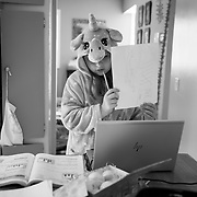 A tutor works with Brooklyn via Zoom to prepare her for a test the next day in 3rd grade math. Brooklyn stayed in her pajamas, unicorn robe and slippers all day, according to her mom, Erin.