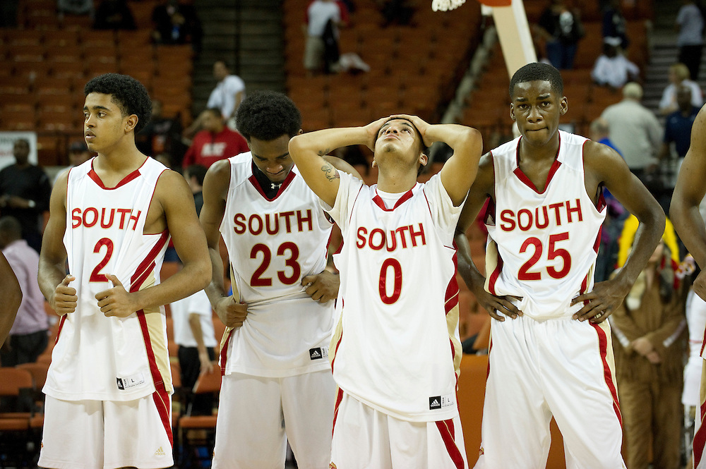 Jaelan Austin (2), Jalon Anderson (23), Andrew Montague (0) and DJ Thorpe (25) of South Grand Prairie react after losing to Fort Bend Travis in the UIL 5A state championship game at the Frank Erwin Center in Austin on Saturday, March 9, 2013. (Cooper Neill/The Dallas Morning News)