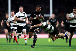 New Zealand's Waisake Naholo (centre) in action during the Autumn International match at Twickenham, London.