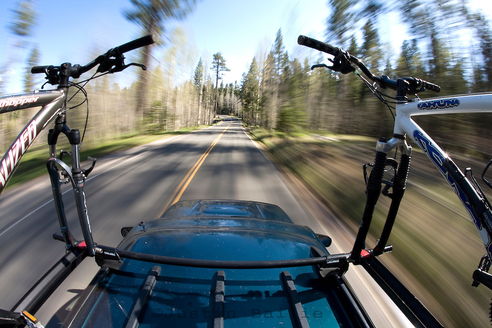 Unique perspective mountain bikes on rack of  traveling car. Lake Tahoe, CA
