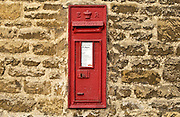 Wall Mounted Post-Box showing the cipher ER for the reign of Queen Elizabeth II, Burford