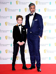 Roman Griffin Davis and Taika Waititi in the press room at the 73rd British Academy Film Awards held at the Royal Albert Hall, London.