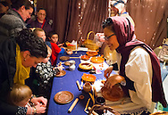 Garden City, New York, USA. December 6, 2013. At A Night in Bethlehem, visitors experience what it might have been like the night Jesus was born. Families visit different shops and participate in projects. Finally the children and adults experience the nativity scene at the manger, with Mary, Joseph, and baby Jesus, on the first Christmas. This free annual Advent event is December 6, 7, and 8, at the Lutheran Church of the Resurrection, on Long Island.