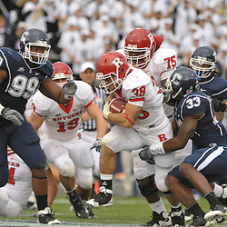 Oct 31, 2009; East Hartford, CT, USA; Rutgers running back Joe Martinek (38) drags Connecticut safety Robert Vaughn (33) during second half Big East NCAA football action in Rutgers' 28-24 victory over Connecticut at Rentschler Field.