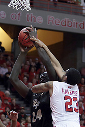 """20 March 2017:  Deontae Hawkins(23) gets all over 7'6"""" Tacko Fall trying to stop his shot during a College NIT (National Invitational Tournament) 2nd round mens basketball game between the UCF (University of Central Florida) Knights and Illinois State Redbirds in  Redbird Arena, Normal IL"""