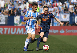 February 24, 2019 - Leganes, Madrid, Spain - Oscar of Leganes and Gameiro of Valencia in action during La Liga Spanish championship, football match between Leganes and Valencia, February 24th, Butarque stadium, in Leganes, Madrid, Spain. (Credit Image: © AFP7 via ZUMA Wire)