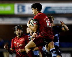 Joey Carbery of Munster claims the high ball despite pressure from Gareth Anscombe of Cardiff Blues<br /> <br /> Photographer Simon King/Replay Images<br /> <br /> Guinness PRO14 Round 4 - Cardiff Blues v Munster - Friday 21st September 2018 - Cardiff Arms Park - Cardiff<br /> <br /> World Copyright © Replay Images . All rights reserved. info@replayimages.co.uk - http://replayimages.co.uk