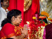"23 SEPTEMBER 2018 - BANGKOK, THAILAND:  A woman prays at the Ganesha Festival at Wat Dan in Bangkok. Ganesha Chaturthi also known as Vinayaka Chaturthi, is the Hindu festival celebrated on the day of the re-birth of Lord Ganesha, the son of Shiva and Parvati. The festival, also known as Ganeshotsav (""festival of Ganesha"") is observed in the Hindu calendar month of Bhaadrapada, starting on the the fourth day of the waxing moon. The festival lasts for 10 days, ending on the fourteenth day of the waxing moon. Outside India, it is celebrated widely in Nepal and by Hindus in the United States, Canada, Mauritius, Singapore, Thailand, Cambodia, and Burma.    PHOTO BY JACK KURTZ"