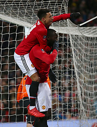 Manchester United's Romelu Lukaku celebrates scoring his side's first goal of the game with Manchester United's Jesse Lingard
