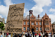 MERTHYR TYDFIL, WALES - 07 JUNE 2020 -  Free Wales fights racism sign during protest (Credit: John Smith / Same Old Smith Photography)