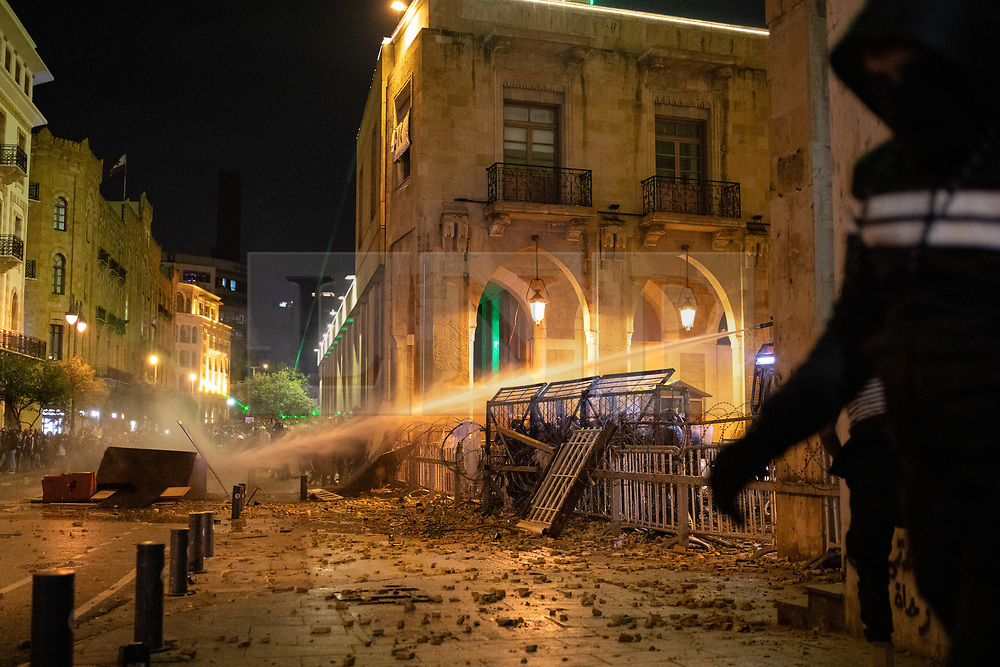 """© Licensed to London News Pictures. 19/01/2020. Beirut, Lebanon. Tear gas and water cannon are used as anti-government demonstrators clash with police in Downtown Beirut, outside the government buildings. The army were later called in to disperse demonstrators. Violence has been escalating in the capital during a """"week of wrath"""", where demonstrators have been campaigning against government corruption and economic crisis. Photo credit : Tom Nicholson/LNP"""