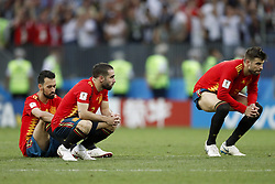 (L-R) Sergio Busquets of Spain, Daniel Carvajal of Spain, Gerard Pique of Spain during the 2018 FIFA World Cup Russia round of 16 match between Spain and Russia at the Luzhniki Stadium on July 01, 2018 in Moscow, Russia