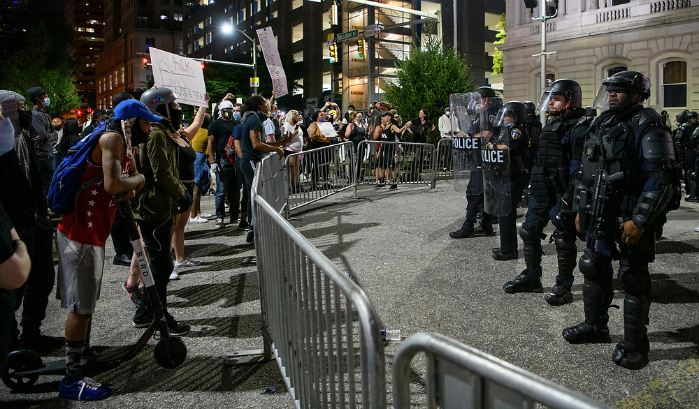Protests in Baltimore carry into the night, with many at City Hall. Protesters are out nationwide after the killing of George Floyd by Minneapolis police. The protests in Baltimore were mostly non violent with only the occasional pepper balls shot into the crowd to keep them off the barrier.