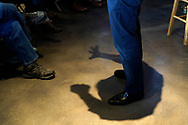 The shadow of Democratic 2020 U.S. presidential candidate and billionaire activist Tom Steyer speaking at a town hall meeting in Ankeny, Iowa U.S. January 28, 2020.     REUTERS/Rick Wilking