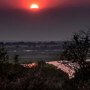 20211007 Kasane Botswana <br /> Chobe Nationalpark <br /> solnedgång över Chobe river<br /> ----<br /> FOTO : JOACHIM NYWALL KOD 0708840825_1<br /> COPYRIGHT JOACHIM NYWALL<br /> <br /> ***BETALBILD***<br /> Redovisas till <br /> NYWALL MEDIA AB<br /> Strandgatan 30<br /> 461 31 Trollhättan<br /> Prislista enl BLF , om inget annat avtalas.