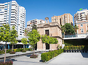 Old chapel surrounded by newly redeveloped port area of shops and bars Malaga, Spain, Muelle dos, Palmeral de las Sorpresas