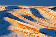 Hills in the valley of the Oldman River in winter at sunset<br /> Oldman Valley<br /> Alberta<br /> Canada
