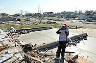 Brook Dingledine (L) gets a hug from her neighbor Nichole Janardhan  after their homes were destroyed in Washington, Illinois on November 18, 2013. Six people died and hundreds of homes were destroyed in Illinois as 81 tornadoes were sighted on November 17 throughout 12 midwest states.  (UPI)