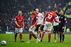 Referee Mark Clattenburg shows a yellow card to Nottingham Forest Defender Elliott Ward (ENG) during the second half of the match - Photo mandatory by-line: Rogan Thomson/JMP - Tel: Mobile: 07966 386802 19/01/2013 - SPORT - FOOTBALL - Pride Park - Derby. Derby County v Nottingham Forest - npower Championship. The meeting of these two local sides is known as the East Midlands Derby with the winner claiming the Brian Clough Trophy.