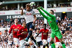 David De Gea of Manchester United punches clear from Harry Kane of Tottenham Hotspur - Rogan Thomson/JMP - 14/05/2017 - FOOTBALL - White Hart Lane - London, England - Tottenham Hotspur v Manchester United - Premier League.