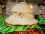"""14 JANUARY 2015 - BANGKOK, THAILAND:  A woven pith helmet worn by a participant in the 2015 Discover Thainess parade. The Tourism Authority of Thailand (TAT) sponsored the opening ceremony of the """"2015 Discover Thainess"""" Campaign with a 3.5-kilometre parade through central Bangkok. The parade featured cultural shows from several parts of Thailand. Part of the """"2015 Discover Thainess"""" campaign is a showcase of Thailand's culture and natural heritage and is divided into five categories that match the major regions of Thailand – Central Region, North, Northeast, East and South.    PHOTO BY JACK KURTZ"""