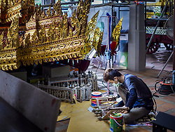 July 19, 2017 - Bangkok, Bangkok, Thailand - An artisan paints wood details and refurbishes for the Minor Royal Chariot, originally made in 1795, which will lead the King's funeral procession. Thai craftsmen at the National Museum in Bangkok are working on the royal chariots that will be used in the cremation procession of Bhumibol Adulyadej, the Late King of Thailand. The King, also known at Rama IX, was revered by the Thai people, who continue to make pilgrimages to the Grand Palace in Bangkok to pay their respects. The King died at age 88 on October 13, 2017. His funeral will be October 25 - 28, 2017 with the actual cremation at Sanam Luang, in Bangkok, on 26 October. (Credit Image: © Sean Edison via ZUMA Wire)