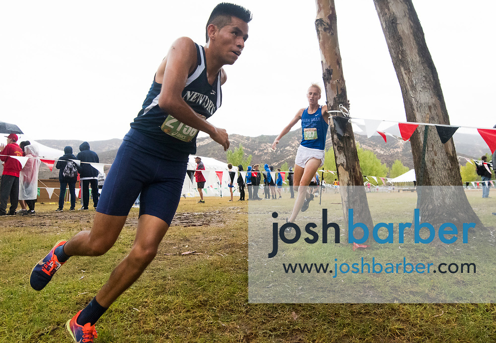 Newport Harbor's Alexis Garcia take the lead from Dana Hills' Simon Fuller during the final quarter mile of the Boys Varsity Sweepstakes race of the Orange County Cross Country Championships at Oak Canyon Park on Saturday, October 13, 2018 in the unincorporated community of Silverado, Calif. (Photo by Josh Barber, Contributing Photographer, Orange County Register)