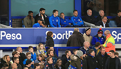 Everton players watch from the dugout during the Carabao Cup, third round match at Goodison Park, Liverpool.