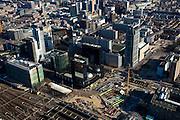 Nederland, Zuid-Holland, Rotterdam, 20-03-2009; aanleg Rotterdam Centraal, nieuw station ook wel OV-terminal (of OV-knooppunt). Vervanging en uitbreiding van het oude Centraal Station (linksonder) was noodzakelijke omdat in de toekomst ook HSL-Zuid en RandstadRail van het nieuwe vervoersknooppunt gebruik zullen maken. Verder in beeld: het Groothandelsgebouw (rechtsonder) met daar direct boven de Weena-toren, links van het midden hoofdkantoor Nationale Nederlanden. Air view on the center of Rotterdam, the replacement and enlargement of the old Central Station of Rotterdam (bottom left), in connection with the HSR. Swart collectie, luchtfoto (toeslag); Swart Collection, aerial photo (additional fee required).foto Siebe Swart / photo Siebe Swart