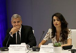September 20, 2016 - New York, New York, United States of America - United States actor George Clooney (L) and wife Amal Clooney attend a Private Sector Call to Action Leaders Summit for Refugees during the United Nations 71st session of the General Debate at the United Nations General Assembly at United Nations headquarters in New York, New York, USA, 20 September 2016..Credit: Peter Foley / Pool via CNP (Credit Image: © Peter Foley/CNP via ZUMA Wire)