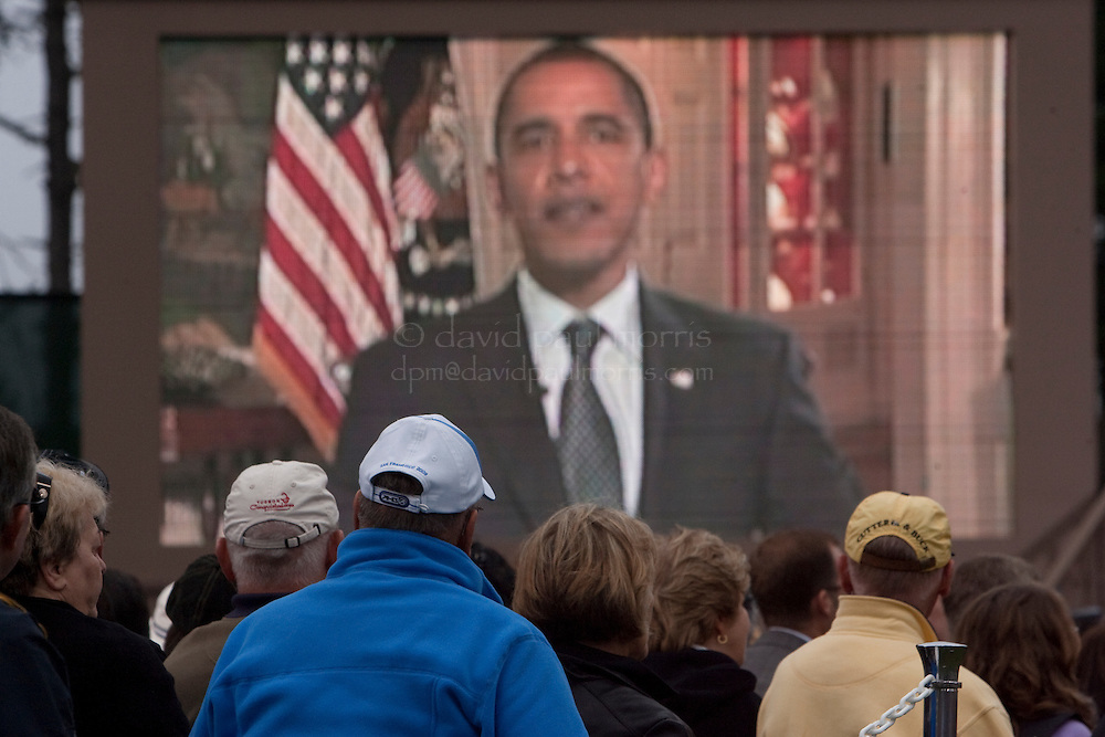 US President Barack Obama speaks to the audience via taped message during opening ceremonies of the 2009 Presidents Cup at Harding Park Golf Course October 7, 2009 in San Francisco, California.  Photograph by David Paul Morris