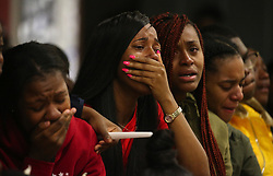 October 8, 2018 - Chicago, IL, USA - Students, faculty and staff weep and comfort each other as they remember and celebrate the life of James Garrett during a memorial on Monday, Oct. 8, 2018 at Butler College Prep in Chicago, Ill. Garrett was shot and killed while attending another vigil. (Credit Image: © Antonio Perez/Chicago Tribune/TNS via ZUMA Wire)