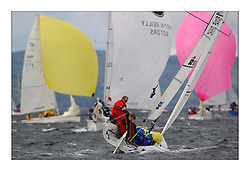 Yachting- The first days inshore racing  of the Bell Lawrie Scottish series 2003 at Tarbert Loch Fyne.  Light shifty winds dominated the racing...Flaming Moe, IRL3040,..SB3 racing upwind through the 1720 fleet...Pics Marc Turner / PFM