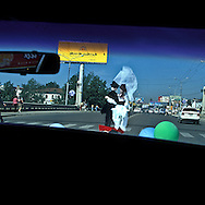 Mongolia. a toy couple wedding symbol on a car driving in ulan baatar