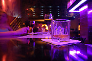 Tel Aviv, Israel, Night shot of the interior of a bar, a glass of whiskey on the counter