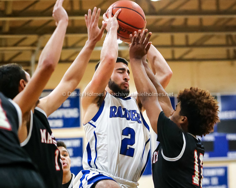 (2/1/16, HOPEDALE, MA) Hopedale's Steven Stuppiello goes up for two points during the boys basketball game against Worcester at Draper Gym in Hopedale on Monday. Daily News and Wicked Local Photo/Dan Holmes