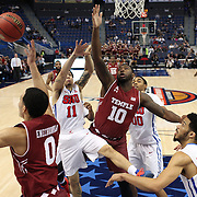 Mark WIlliams, (center), Temple and Nic Moore, SMU, challenge for a rebound during the Temple Vs SMU Semi Final game at the American Athletic Conference Men's College Basketball Championships 2015 at the XL Center, Hartford, Connecticut, USA. 14th March 2015. Photo Tim Clayton