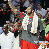 14 March 2012: Chicago Bulls power forward Carlos Boozer (5) congratulates his teammates from the bench during the Chicago Bulls 106-102 victory over the Miami Heat at the United Center, Chicago, Illinois, USA.