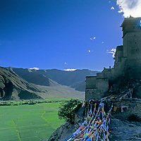 Fortress-like Yumbu Lakang temple, the oldest dwelling in Tibet, above barley fields near Tsedang.