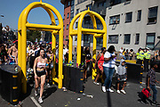 Security barriers at Notting Hill Carnival on 26th August 2019 in West London, United Kingdom. A celebration of West Indian / Caribbean culture and Europes largest street party, festival and parade. Revellers come in their hundreds of thousands to have fun, dance, drink and let go in the brilliant atmosphere. It is led by members of the West Indian / Caribbean community, particularly the Trinidadian and Tobagonian British population, many of whom have lived in the area since the 1950s. The carnival has attracted up to 2 million people in the past and centres around a parade of floats, dancers and sound systems.